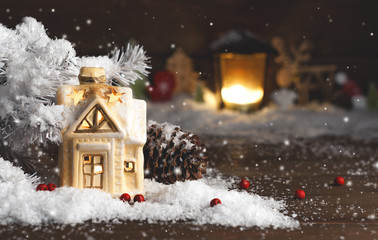 decorative christmas decorations, a house on a snowy background