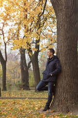 Handsome man in the autumn park
