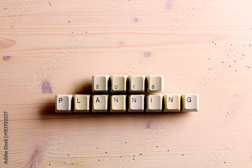 Planning 2018 new year on computer keyboard keys buttons on a wooden