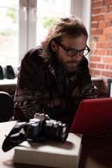 Male graphic designer working on laptop