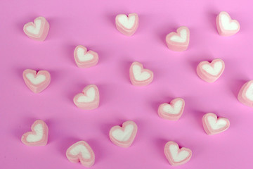 marshmallow heart shape with love concept on pink background