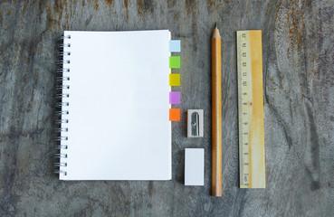 Set of wooden writing tools, pencil, pen, ruler, eraser, sharpener and book