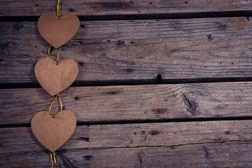Heart shaped christmas decoration on wooden plank