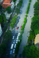 Miniature of Ho Chi Minh City traffic with motorbikes and cars, top-view