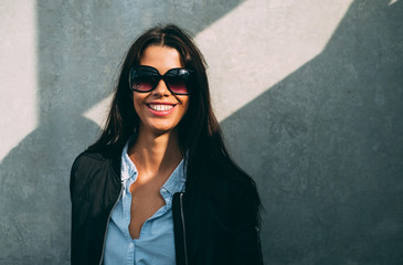 Portrait of a smiling woman wearing sunglasses