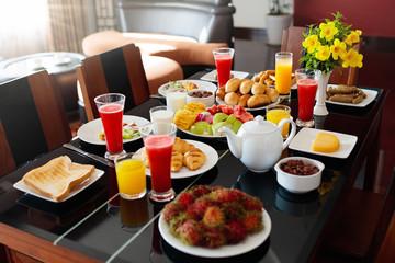 Healthy family breakfast. Fruit, bread, juice.