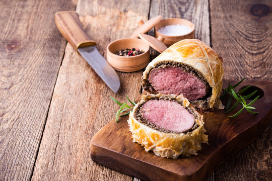 Beef Wellington, classic steak dish on cutting board