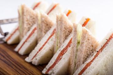 English tea sandwiches platter on wooden board