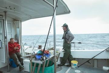 Fishermen sailing on boat