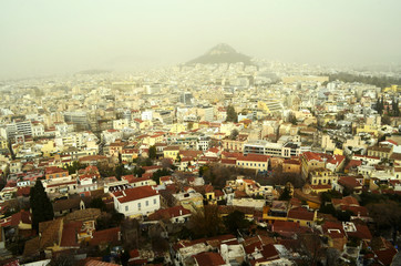 View of the neighborhoods of Anafiotika and Plaka in a winter day, from the Acropolis of Athens Greece