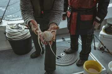 Fisherman holding octopus