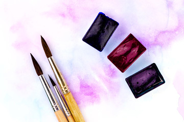 Palette of watercolor paints and brushes