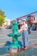 Female is washing her hands in a public fountain - Kas, Antalya