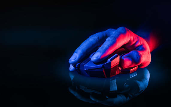 Close up of Hand over wireless Game Mouse on dark background