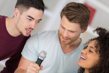 trio doing a song