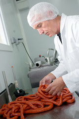 meat packer making sausages