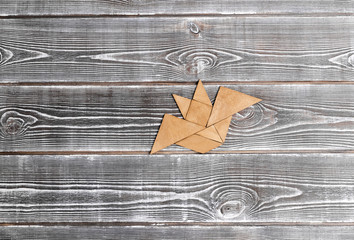bat figure on a wooden background