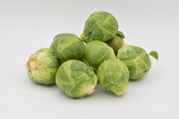 Brussel Sprouts Arranged on a White Background
