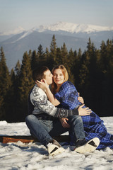 Young couple outdoors in winter park