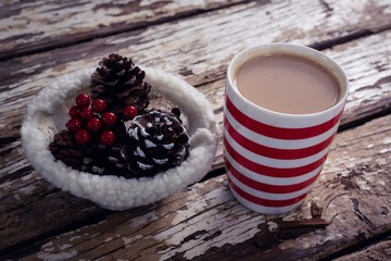 Coffee and christmas decoration on wooden plank