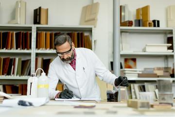 Engineer in the laboratory examines ceramic tiles