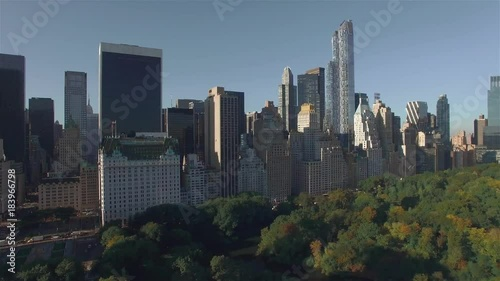 Aerial, camera is flying above Central Park, approaching to