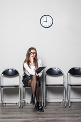 Still waiting for the job interview and woman checking time on white background