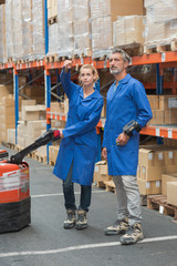 woman and warehouse worker discussing something