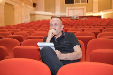 concentrated director in movie theater