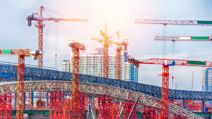 Large construction site including several cranes working on a building complex.Business construction concept Wall mural