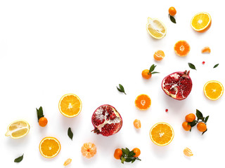 Composition from orange, pomegranate, mandarins with leaves isolated on white background. Food pattern of fruits. Creative flat layout of fruit slices, top view.