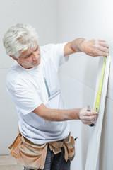 Mason preparing plasterboard