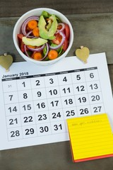 Calendar with new year resolution and diet food