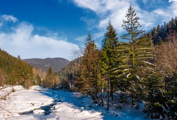 Tereblya river of Carpathian mountains in winter. Beautiful scenery in rural part of Synevir National park