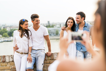 Group of young people being photographed