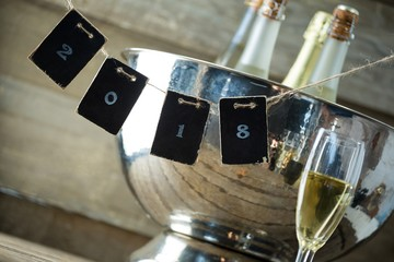 Champagne bottles in ice bucket and cads forming 2018