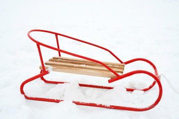 wooden sled on the snow - copy space