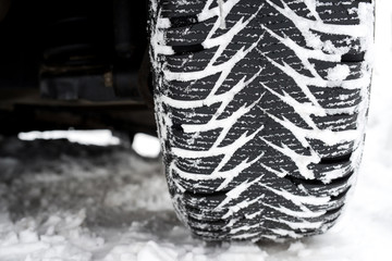 Close up of a tire with winter thread