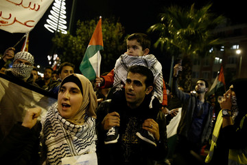 People take part in a protest against Donald Trump's decision to recognise Jerusalem as the capital of Israel, in Athens