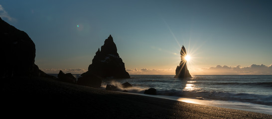 Troll toes on black beach at sunrise, Vik, Iceland. Landscape photography