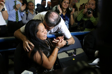 Teodora del Carmen Vasquez is embraced by a supporter as she arrives to a court of justice for a sentence review hearing in San Salvador