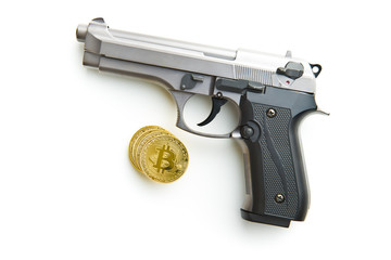 Golden bitcoins. Cryptocurrency and handgun.