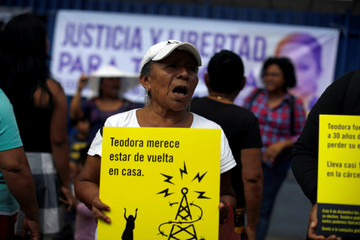 Women protest in support of Teodora del Carmen Vasquez outside the Isidro Menendez Courthouse during a sentence review hearing in San Salvador