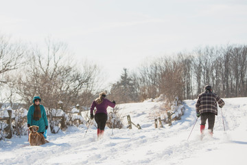 People greet each other while enjoying snow after the first lake-effect snowfall of the season at Knox Farm State Park in the Buffalo suburb of East Aurora