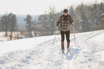 A man cross-country skis through the snow after the first lake-effect snowfall of the season at Knox Farm State Park in the Buffalo suburb of East Aurora