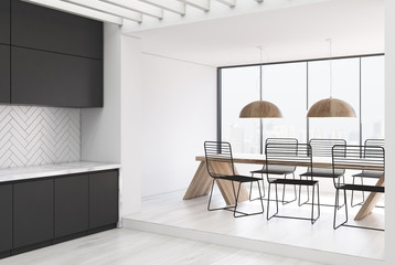 White wooden kitchen and a dining room, gray