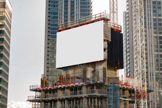 Empty billboard on a construction site