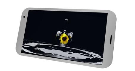 Handy auf dessen display ein Bild mit einem Wassertropfen und einer Sonnenblume ist