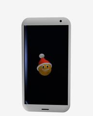 Handy auf dem ein Emoticon mit Weihnachtsmütze ist