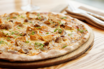 Pizza with porcini mushrooms, close-up